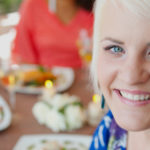 Healthy woman eating with friends Nutrition Intuition's website header