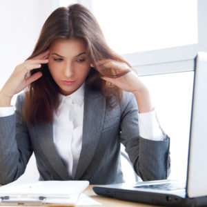 woman feeling tired at work